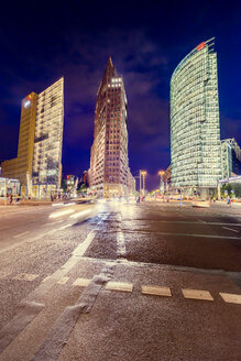 Road intersection and illuminated skyscrapers at night - FOLF00927