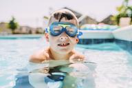 Portrait of boy in swimming pool - CAVF28714