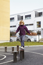Girl walking on wooden posts - FOLF01306