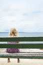 Girl sitting on bench and looking at sea in Croatia - FOLF01324