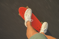 Low-section shot of skater riding red shortboard - FOLF01345