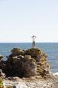 Rear view of man on rock - FOLF01495