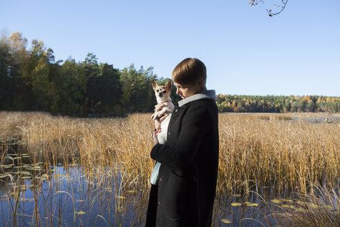 Woman with dog in wetland - FOLF01588