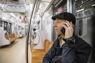 Man talking on phone in subway - FOLF01869
