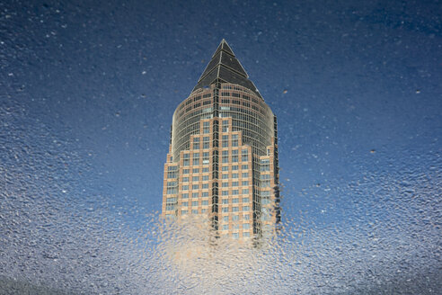 Germany, Hesse, Frankfurt, Trade Fair Tower, mirrored in puddle - WIF03485