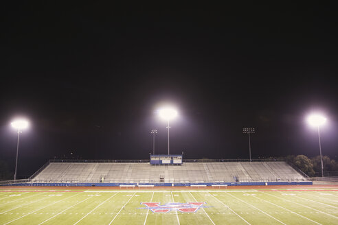 High angle view of American football stadium against sky at night - CAVF29650