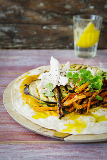 Pulled Chicken Wrap, carrot, grilled aubergine, curry hummus and herbs on chopping board - KSWF01889