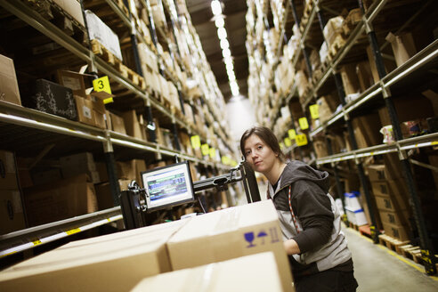 Young woman working in warehouse - FOLF02074