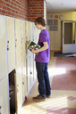 Teenage boy opening locker - FOLF02128