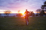 Boy cycling at sunset - FOLF02182