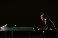 Man playing table tennis against black background - CAVF29904