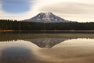 Scenic view of Mount Rainier and lake against cloudy sky - CAVF30054