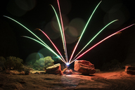 Display of fireworks over field at night - CAVF30156