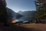 Campfire by lake against sky - CAVF30312