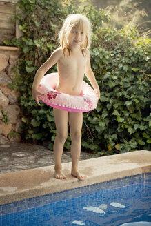 Girl standing on swimming pool edge - FOLF02389