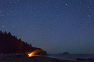 Campfire at Olympic Coast against star field during night - CAVF30397