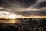 Scenic view of city and Guanabara Bay against cloudy sky during sunset - CAVF30609