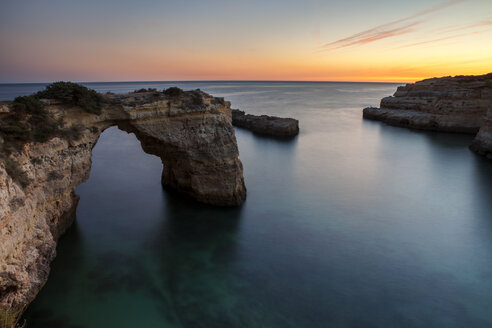 View of natural arch in sea at Algarve - CAVF30663