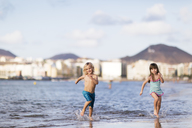 Children running on beach - FOLF03175