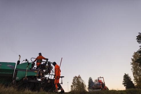 Two Manual workers repairing road - FOLF03241