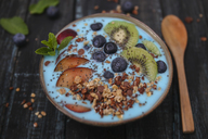 Superfood smoothie bowl with chia seeds, blueberries, nectarine, kiwi and chocolate granola - RTBF01109
