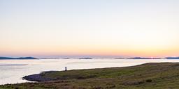 United Kingdom, Scotland, Highland, Loch Broom, near Ullapool, Rhue Lighthouse at sunset - WDF04502