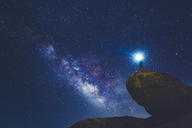 Man standing on rock in Joshua Tree National Park and looking at Milky Way - FOLF03632