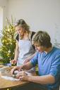 Couple preparing christmas cookies - FOLF03650