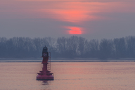 Germany, Hamburg, Wittenbergen, Elbe river and lateral bouy at sunset - KEBF00772