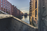 Germany, Hamburg, Speicherstadt, View from Poggenmuhlen bridge to Water Castle at sunset - KEBF00775