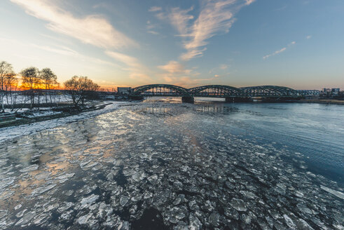 Germany, Hamburg, Freihafenelbbruecke, Elbe river and ice at sunset - KEBF00787