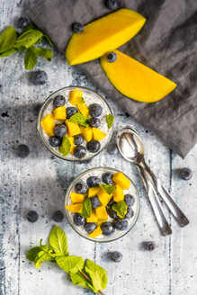Two glasses of chia pudding with mango and blueberry - SARF03634