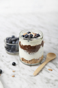 Jar of chia pudding parfait with chocolate and yoghurt with blueberries and granola - RTBF01118