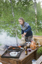 Woman cooking on a fire pit - FOLF04781