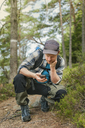 Man using Smartphone in forest - FOLF05126
