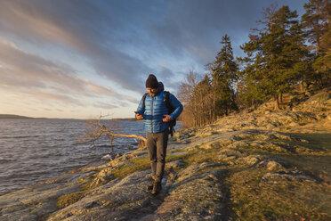 Man walking along coastline - FOLF05201