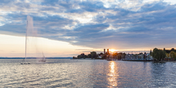 Germany, Baden-Wuerttemberg, Friedrichshafen, Lake Constance, city view, marina, fountain at sunset - WDF04521
