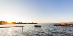 Germany, Baden-Wuerttemberg, Langenargen, Lake Constance, shipping pier at sunrise - WDF04524