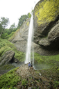 High angle view of couple looking at waterfall - CAVF31258