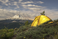 Tent on mountain against sky during sunset - CAVF31336