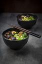 Japanese miso soup with sugar peas, shitake mushrooms, tofu and mung sprouts - LVF06831