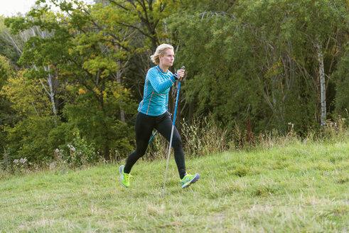 Woman hiking in grass - FOLF05667
