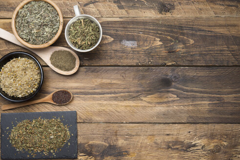 Various herbal infusions on wood, chamimile, mint, rooibos, thyme, green tea, tisane - SKCF00375