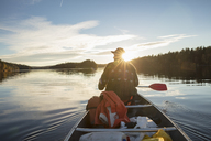 Rear view of man paddling boat on lake - FOLF05919