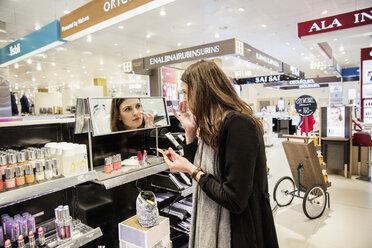 Woman testing foundation in perfumery - FOLF05977
