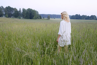 Woman walking in meadow - FOLF06010
