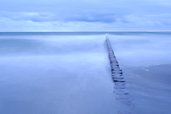 Seascape with breakwater under moody sky - FOLF06019