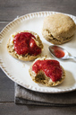Scones made of einkorn wheat with strawberry jam and clotted cream - EVGF03331