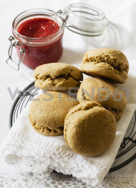 Scones made of einkorn wheat with strawberry jam and clotted cream - EVGF03334