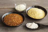 Spoons of Golden and brown millet, millet meal and millet flakes - EVGF03337